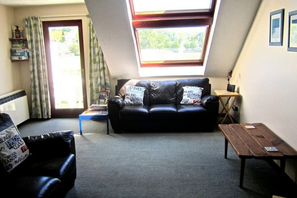 A Spacious Lounge With Entertainment Including Smart TV, CD Player And An Ipod Docking Station