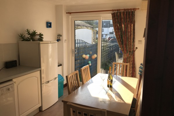 Sunny Kitchen Dining Room Opens Onto Patio Garden